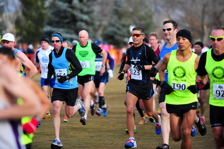 Chief Master Sgt. Alex C. Escarcega (bib number 123) is seconds into his race Feb. 15, 2014, at Flatirons Golf Course in Boulder, Colo. Escarcega was the sole reservist to compete in the 2014 Armed Forces Cross-Country Championship's 8-kilometer event. He finished with a time of 34:24 in the Men's Master category. Escarcega is assigned to the 310th Operations Group at Schriever Air Force Base, Colo., and serves as the organization's chief enlisted manager. (U.S. Air Force photo/Tech. Sgt. Nicholas B. Ontiveros)