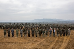 Multinational dignataries, representing the participating nations of exercise Cobra Gold 2014, pose for a group photograph after the conlusion of a combined live-fire exercise that marked the end of the exercise at Royal Thai Navy Tactical Training Center Ban Chan Krem, Chantaburi, Kingdom of Thailand, Feb. 21. Cobra Gold, in its 33rd iteration, demonstrates the U.S. and the Kingdom of Thailand's commitment to our long-standing alliance and regional partnership, prosperity and security in the Asia-Pacific region.