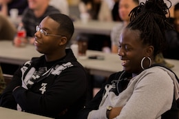 """Bianca Hawkins and her husband, Lance Cpl. Omar Hawkins, react to a joke told by Cmdr. Ray Bailey during a """"P.S., before you say I do"""" seminar at the Blinder Memorial Chapel, Feb. 19. The Naval Hospital Camp Pendleton hosted the seminar to educate Marines, sailors and their significant others about potential stressors and difficulties that could arise during the early stages of marriage. Omar is a warehouse clerk with Headquarters and Support Battalion. Bailey is the deputy command chaplain for Marine Corps Installations West."""