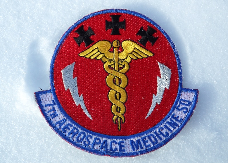 The 7th Aerospace Medicine Squadron patch lies in the snow beneath the South Pole Jan. 10, 2014, at Amundsen-Scott South Pole Station, Antarctica. Maj. Andrew Allen, 7th AMDS, deployed to McMurdo Station in support of Operation Deep Freeze. While stationed there, Allen's primary mission was to support the flying mission, casualty evacuations and patient movement across the continent. (Courtesy photo)