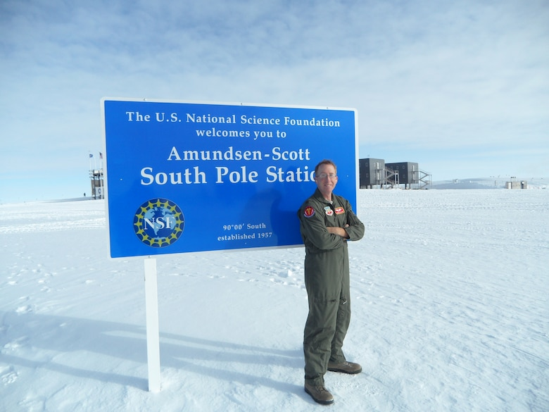 U.S. Air Force Maj. Andrew Allen, 7th Aerospace Medicine Squadron, stands near the South Pole Jan. 10, 2014, at Amundsen Scott South Pole Station, Antarctica. When they were not busy with walk-ins, follow up appointments, studying or training, Allen's team had opportunities to observe the unique landscapes and wild life of Antarctica. (Courtesy photo)