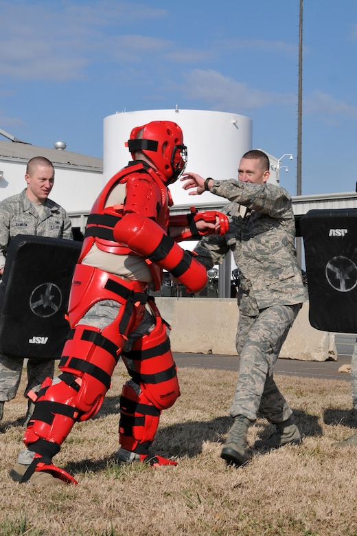 U.S. Air Force Staff Sgt. Darren Shopbell, assigned to the 145th Security Forces Squadron, uses a collapsible ASP baton during tactile baton training against 1st Lieutenant Adam Cassidy, 145th Anti-Terrorist Officer.  Cassidy, wearing a red protective suit, and other members of 145th SFS held the ASP training at North Carolina Air National Guard base, Charlotte Douglas Intl. airport, February 9, 2014.  145th SFS members train as part of a yearly requirement to keep their non-lethal ASP certification current. (U.S. Air National Guard photo by Senior Airman Laura Montgomery, 145th Public Affairs/Released)