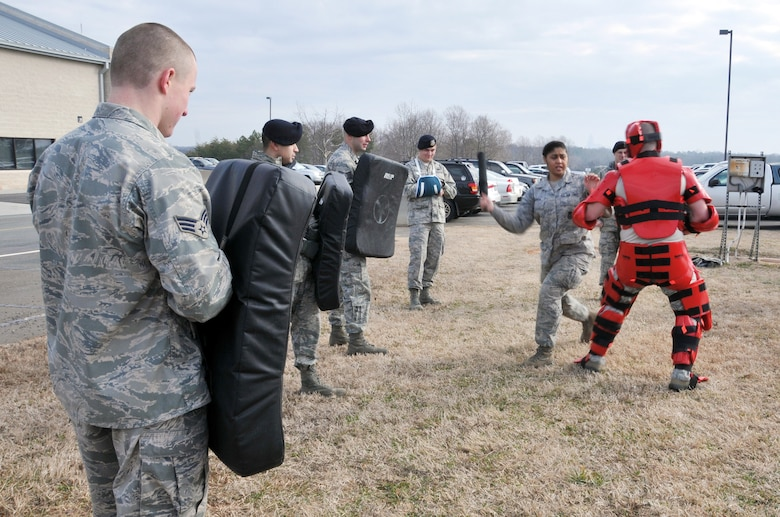 Members assigned to the 145th Security Forces Squadron, use ASP Baton Strike Pad and collapsible ASP batons during a training held at North Carolina Air National Guard base, Charlotte Douglas Intl. airport, February 9, 2014.  Security Forces must keep their certification in non-lethal ASP as part of their yearly requirements. (U.S. Air National Guard photo by Senior Airman Laura Montgomery, 145th Public Affairs/Released