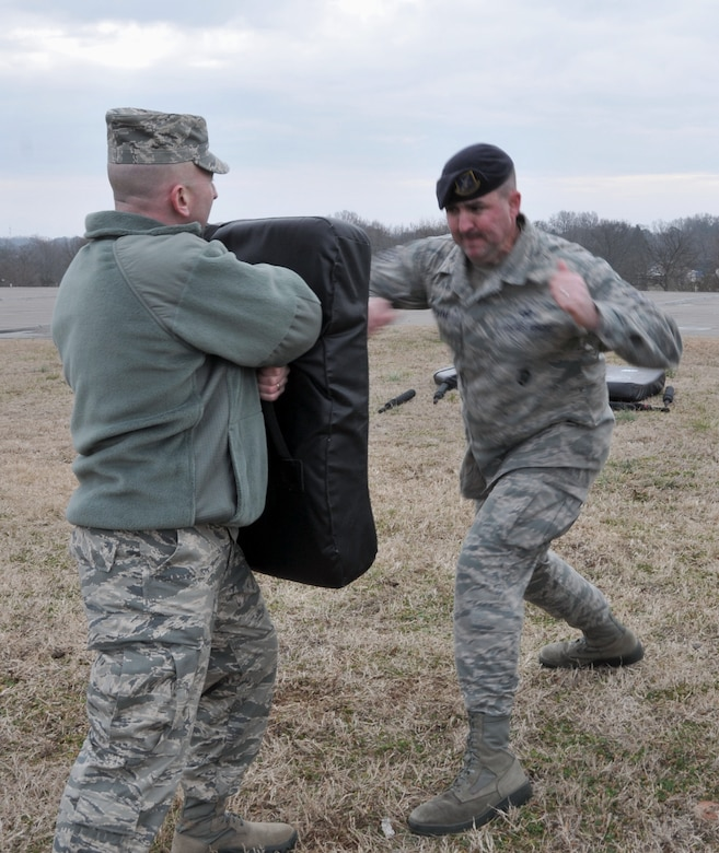 U.S. Air Force Staff Sgt. Timothy Van Dyke, 145th Security Forces Squadron, demonstrates the proper techniques of using a collapsible ASP tactical baton as part of a yearly requirement for 145th SFS members to keep their certification in non-lethal ASP current.  Van Dyke conducted the training teaching lethal and non-lethal defense stances at the North Carolina Air National Guard base, Charlotte Douglas Intl. airport, February 9, 2014. (U.S. Air National Guard photo by Staff Sgt. Pamela Robbins, 145th Public Affairs/Released)