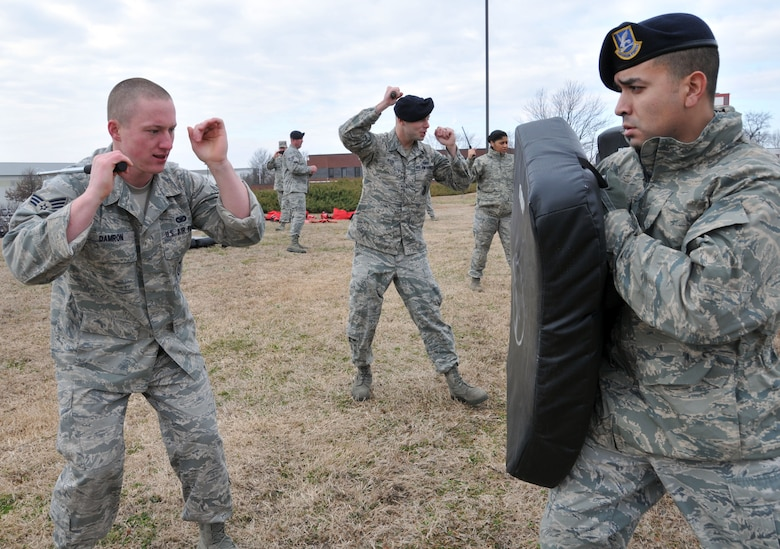 U.S. Air Force Staff Sgt. Norman Dias, 145th Security Forces Squadron, holds on to the ASP Baton Strike Pad as Senior Airman Nicholas Damron prepares to strike during a non-lethal defense training exercise held at the North Carolina Air National Guard base, Charlotte Douglas Intl. Airport, February 9, 2014.  Security Forces must keep their certification in non-lethal ASP current as part of their yearly requirements. (U.S. Air National Guard photo by Staff Sgt. Pamela Robbins, 145th Public Affairs/Released)