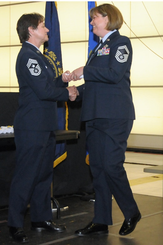 Senior Master Sgt. Tammy L. LaKemper receives her Community College of the Air Force degree from Chief Master Sgt. Brenda Blonigen during the 2014 CCAF commencement ceremony, Pease Air National Guard Base, N.H. February 8, 2014. Thirty-three members of the wing graduated with CCAF associate degrees at the ceremony. (N.H. Air National Guard photo by Staff Sgt. Curtis J. Lenz)