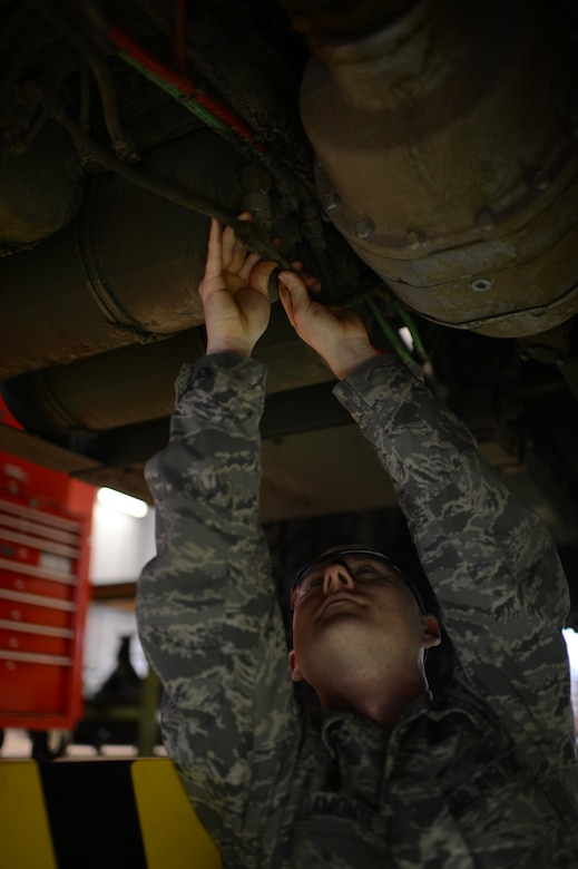 U.S. Air Force Staff Sgt. Michael Lamonte, 606th Air Control Squadron vehicle maintenance technician from Burlington, Calif., checks the air lines of a five-ton troop carrier vehicle on Spangdahlem Air Base, Germany, Feb. 21, 2014. The air lines are checked for leaks during maintenance to ensure proper function of the vehicle. (U.S. Air Force photo by Senior Airman Gustavo Castillo/Released)