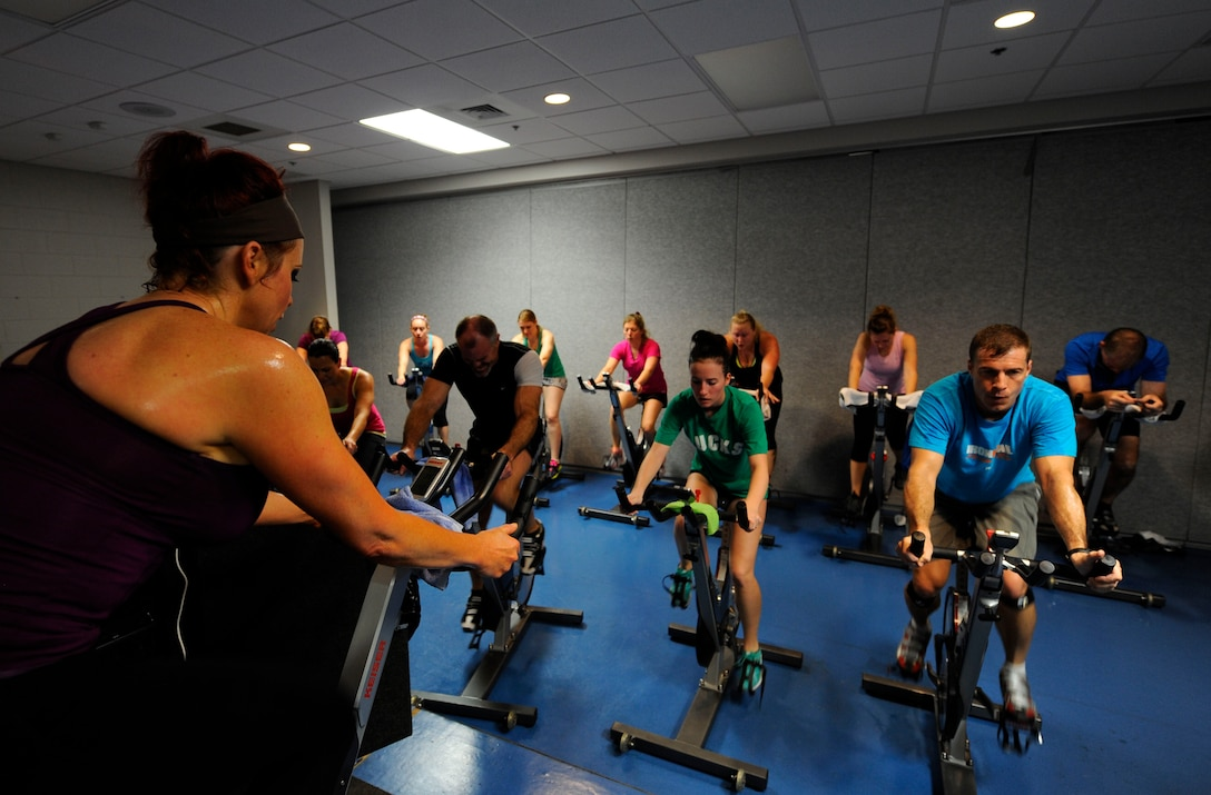 Lisa Pizzo, lead group fitness instructor, instructs her class during a cycle workout at Hurlburt Field, Fla., Feb. 20, 2014. Pizzo said she has taught at the Aderholt Gym since 2005. (U.S. Air Force photo/Airman 1st Class Andrea Posey)