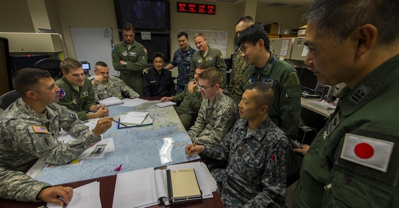 Planners from the U.S. military and Japan Self-Defense Forces engage in missile defense planning during the Integrated Air and Missile Defense Wargame V on Feb. 13, 2014, in the 613th Air Operations Center at Joint Base Pearl Harbor Hickam, Hawaii. The exercise centered around building relationships between the joint U.S. team and Japan's military forces to overcome regional security challenges. (U.S. Air Force photo/Staff Sgt. Nathan Allen)