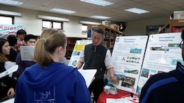 Dr. Chon Song-u, Geologist, Environmental Section talks to Seoul American High School students about environmental remediation during engineer day Feb. 20.