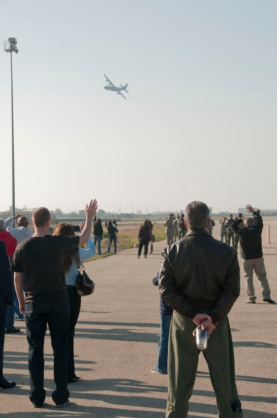 Family and friends wave goodbye to a departing C-130J carrying deploying members from the 146th Airlift Wing Sunday Feb. 23, 2014 at Channel Islands Air National Guard Station, Port Hueneme, Calif. About 130 Airmen and four C-130Js deployed in support of Operation Enduring Freedom in the Middle East. (Air National Guard photo by: Senior Airman Nicholas Carzis)