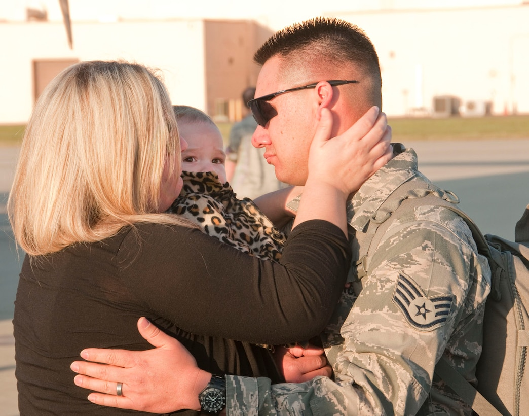 U.S. Air National Guard Staff Sgt. Jessie Racey says goodbye to his family before departing to the Middle East Sunday Feb. 23, 2014. About 130 Airmen and four aircraft departed the 146th Airlift Wing in support of Operation Enduring Freedom. (Air National Guard photo by: Senior Airman Nicholas Carzis)