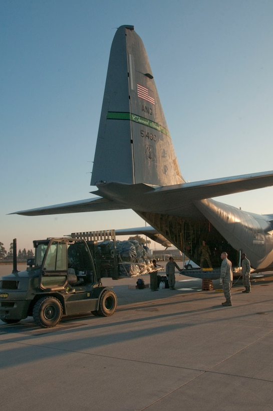 Airmen from the 146th Airlift Wing finish loading a C-130J bound for the Middle East Sunday, Feb. 23, 2014.  About 130 Airmen and four aircraft departed in support of Operation Enduring Freedom. (Air National Guard photo by: Senior Airman Nicholas Carzis)