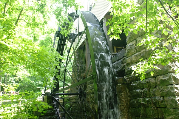 The overshot waterwheel at Mill Springs Mill turns while the mill operates during the 18th Annual Cornbread Festival May 28, 2011.  There was a large turnout of people to see the mill and enjoy the booths and entertainment by scenic Lake Cumberland.