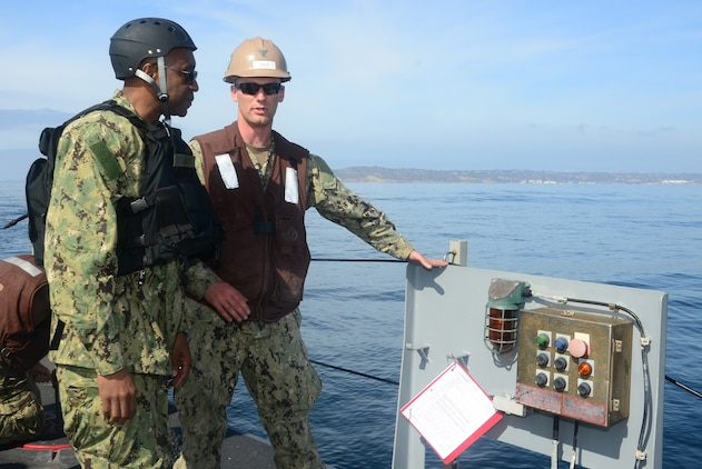 Engineman 2nd Class Jesse Couch, assigned to Amphibious Construction Battalion One, describes the operations of the beach module of Improved Navy Lighterage System Causeway Ferry 17 to Rear Adm. Frank Ponds, commander of Expeditionary Strike Group Three, during exercise Brilliant Scepter 2014. Brilliant Scepter 2014 is an exercise providing ship-to-shore transportation of combat cargo for Navy amphibious forces and the Marine Corps.
