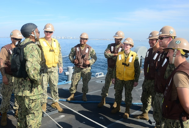 Rear Adm. Frank Ponds, commander of Expeditionary Strike Group Three, talks with the crew of Improved Navy Lighterage System Causeway Ferry 17, assigned to Amphibious Construction Battalion One, during exercise Brilliant Scepter 2014. Brilliant Scepter 2014 is an exercise providing ship-to-shore transportation of combat cargo for Navy amphibious forces and the Marine Corps.