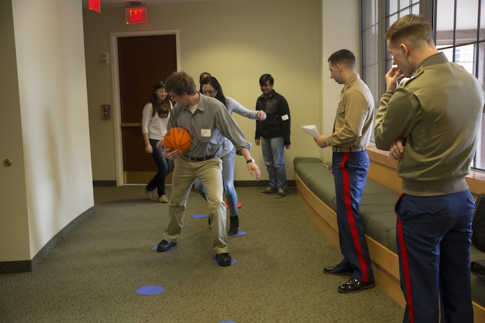 Second Lt. Christopher Perino, guest instructor at the Marine Corps Leadership Seminar (MCLS), watches over Virginia Commonwealth University students as they execute a training exercise designed to help utilize their leadership skills, Feb. 21. The MCLS is a program designed to spread awareness of the Marine Corps as well as teach college students valuable leadership traits and characteristics.