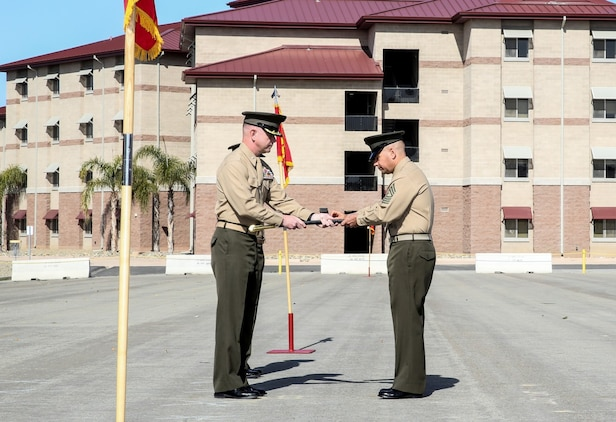 Lieutenant Col. John O'Neal, left, commanding officer, 15th Marine Expeditionary Unit, presents the noncommissioned officer's sword to Sgt. Maj. Douglas B. Schaefer, signifying the transfer of enlisted authority as the 15th Marine Expeditionary Unit Sergeant Major during a relief and appointment ceremony aboard Camp Pendleton Calif., Feb. 21, 2014. (U.S. Marine Corps photo by Cpl. Emmanuel Ramos/Released)