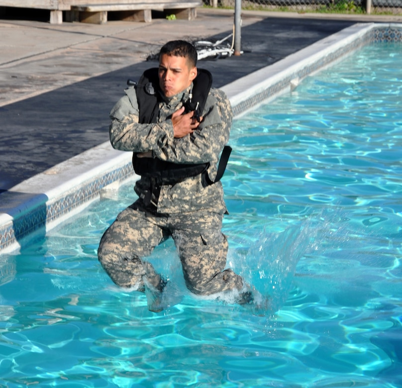Members of Joint Task Force-Bravo took the Combat Water Survival Test (CWST) at Soto Cano Air Base, Honduras, Feb. 24, 2014. The testing was conducted in the base swimming pool, and required participants to accomplish tasks including swimming 50 meters in uniform and boots, and treading water and floating for five minutes. JTF-Bravo members also trained on helocasting techniques as well as procedures for recovery from water via hoist. The training was conducted in preparation for future JTF-Bravo exercises and operations. (U.S. Air Force photo by Capt. Zach Anderson)