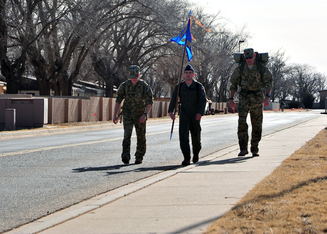 "U.S. Air Force Air Commandos from Cannon Air Force Base, N.M., walk during a six-mile memorial ruck march, Feb. 18, 2014 at Cannon's Unity Park. The march was conducted in honor of Capt. Ryan Hall, Capt. Nicholas Whitlock, 1st Lt. Justin Wilkens and Senior Airman Julian Scholten, the aircrew members who lost their lives when ""Ratchet 33"", a U-28A, crashed in Djibouti, Africa, Feb. 18, 2012. (U.S. Air Force photo/Senior Airman Whitney Amstutz)"