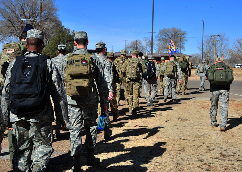 """U.S. Air Force Air Commandos from Cannon Air Force Base, N.M., begin a six-mile memorial ruck march, Feb. 18, 2014 at Cannon's Unity Park. The march was conducted in honor of Capt. Ryan Hall, Capt. Nicholas Whitlock, 1st Lt. Justin Wilkens and Senior Airman Julian Scholten, the aircrew members who lost their lives when """"Ratchet 33"""", a U-28A, crashed in Djibouti, Africa, Feb. 18, 2012. (U.S. Air Force photo/Senior Airman Whitney Amstutz)"""