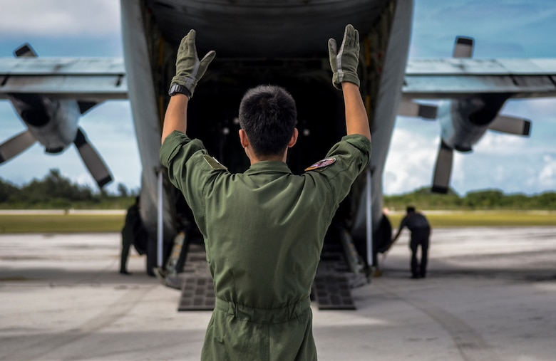 Japan Air Self-Defense Force Master Sgt. Hiroshi Moriyama guides a forklift out of a C-130 Hercules Feb. 19, 2014, at the Rota International Airport. Airmen from the Air Force, Japan Air Self-Defense Force and Royal Australian air force participating in Cope North, a multi-lateral exercise on Andersen Air Force Base, Guam. The exercise transitioned from a scenario-based humanitarian assistance and disaster relief training to real world humanitarian assistance of food and commodities to the citizens of Rota when it was declared to be under a state of emergency following months without their regular resupply by sea. Moriyama is a 401st Squadron Tactical Airlift Wing loadmaster. (U.S. Air Force photo/Senior Airman Marianique Santos)