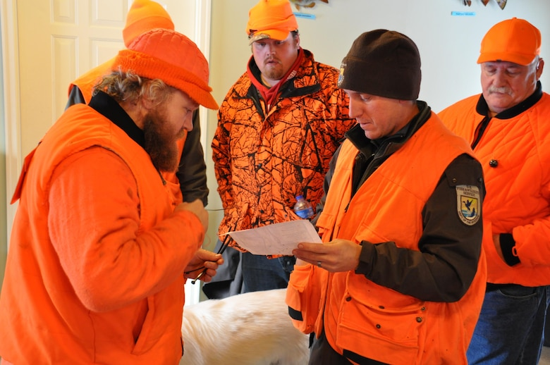 Jon Sobiech, planning, left; Tom Drinken, Wounded Warrior participant; and Scott Pariseau, a U.S. Fish and Wildlife Service volunteer, review a map of the Eau Galle Recreation Area prior to heading out to the deer stands at the park, near Spring Valley, Wis., Dec. 14. This was the second Wounded Warrior hunt at the park.