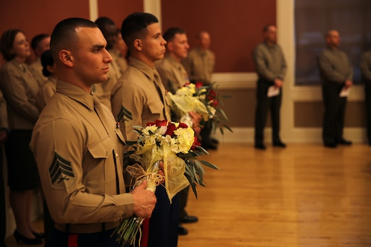 Marines with Combat Logistics Battalion 26, Combat Logistics Regiment 27, 2nd Marine Logistics Group hold flowers during a change of command ceremony at Marston Pavilion aboard Camp Lejeune, N.C., Feb. 21, 2014. During a change of command ceremony, flowers are given to the spouses of the commanding officers.