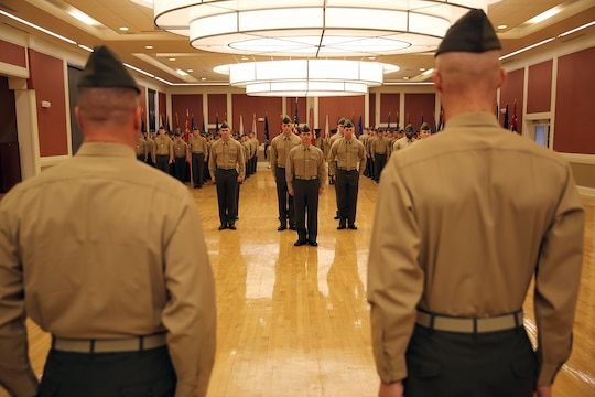 Lt. Col. Kevin G. Collins (left), the outgoing commanding officer and Lt. Col. Daniel H. Coleman (right), the incoming CO of Combat Logistics Battalion 26, Combat Logistics Regiment 27, 2nd Marine Logistics Group, stand at attention while the 'Marine Corps Hymn' is playing during a change of command ceremony at Marston Pavilion aboard Camp Lejeune, N.C., Feb. 21, 2014. A change of command ceremony is passing the total accountability, authority and responsibility of the battalion between two high ranking officers.