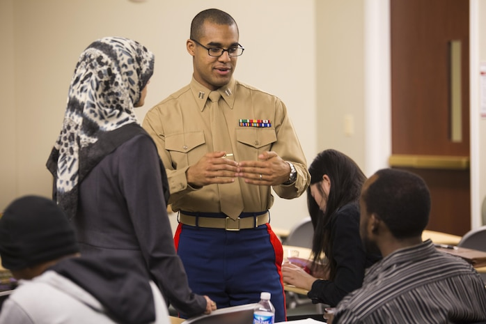 Captain Jordan Harris, an instructor for the Marine Corps Leadership Seminar(MCLS), interacts with students during a break at the MCLS, Virginia Commenwealth University, here, Feb. 21. The MCLS is a program designed to spread awareness of the Marine Corps as well as teach college students valuable leadership traits and characteristics.