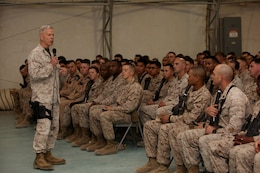 General James F. Amos, commandant of the Marine Corps, addresses Marines and sailors at a town hall meeting aboard Camp Leatherneck, Helmand province, Afghanistan, Feb. 18, 2014. General Amos and Sgt. Maj. Micheal P. Barrett, sergeant major of the Marine Corps, spoke with the Marines about the future of the Marine Corps, the reawakening of the Corps and thanked them for their hard work.