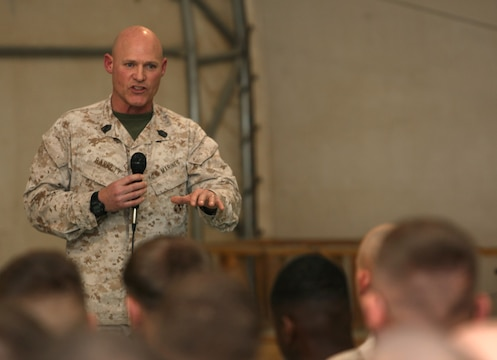 Sergeant Maj. Micheal P. Barrett, sergeant major of the Marine Corps, speaks to Marines and sailors aboard Camp Leatherneck, Helmand province, Afghanistan, during a town hall meeting held Feb. 18, 2014. After Gen. James F. Amos, commandant of the Marine Corps, spoke with the service members about the direction in which the Marine Corps is headed and the reawakening of the Corps, Sgt. Maj. Barrett expressed his gratitude for the Marines and everything they have been doing in Afghanistan.