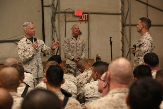 General James F. Amos, left, commandant of the Marine Corps, answers a question about rotational force structure during a town hall meeting held aboard Camp Leatherneck, Helmand province, Afghanistan, Feb. 18, 2014. General Amos and Sgt. Maj. Micheal P. Barrett, sergeant major of the Marine Corps, visited with Marines and sailors of Regional Command (Southwest) to speak about the peacetime Marine Corps force and the reawakening of the Corps.