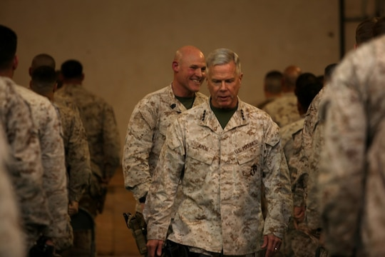 "General James F. Amos, commandant of the Marine Corps, and Sgt. Maj. Micheal P. Barrett, sergeant major of the Marine Corps, leave a town hall meeting after speaking with Marines and sailors aboard Camp Leatherneck, Helmand province, Afghanistan, Feb. 18, 2014. General Amos and Sgt. Maj. Barrett held the meeting to speak about the peacetime Marine Corps Force, the ""reawakening"" of the Corps and to address concerns of the Marines and sailors in Regional Command (Southwest)."