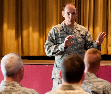 Col. Kevin Kennedy, 28th Bomb Wing commander, addressed his Airmen during a recent commander's call in the Base Theater at Ellsworth Air Force Base, S.D., May 6, 2013. Kennedy emphasized that good order and discipline is a command responsibility, however each member of the wing has a duty to foster a healthy climate and professional environment. (U.S. Air Force photo by Senior Airman Kate Maurer/Released)