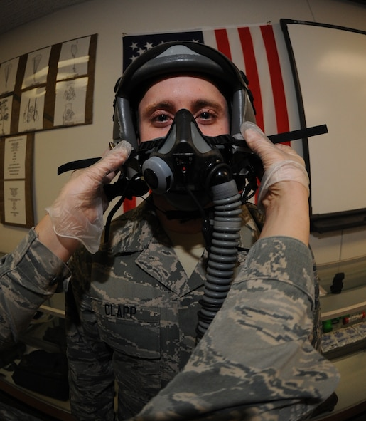 Airman First Class Adam Clapp, 509th Operations Support Squadron aircrew flight equipment technician gets a MBU-20/P soft shell mask fitted to his face at Whiteman Air Force Base Mo., Feb. 18, 2014. The AFE technicians inspect the pilots safety gear before each flight and after each flight as well as 30-day inspections. (U.S. Air Force photo by Airman 1st Class Joel Pfiseiter/Released)