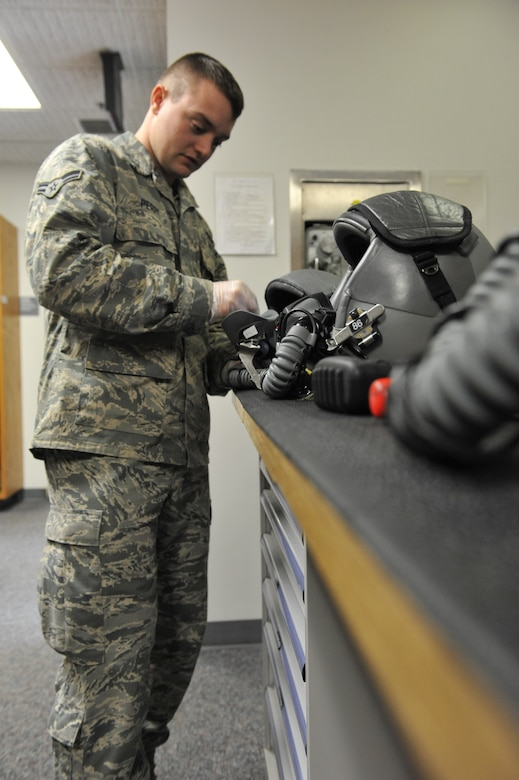 Airman 1st Class Brandon Perry, 509th Operations Support Squadron aircrew flight equipment technician, sanitizes an MBU-20/P soft shell mask. AFE technicians clean the insides of the masks to ensure there are no contaminants, debris or germs in the mask. (U.S. Air Force photo by Airman 1st Class Joel Pfiester/Released)