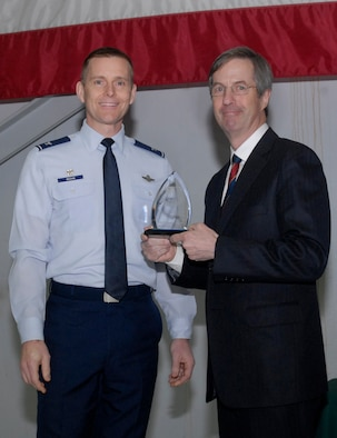 Oregon Air National Guard Col. Rick Wedan, 142nd Fighter Wing Commander and Mr. Bill Wyatt Executive Director for the Port of Portland, pause for a photograph with the Award for Oregon Air National Guard Employer of the Year 2013, during the ceremony to honor the Port of Portland, held at the Portland Air National Guard Base, Ore., Feb. 20, 2014. (Air National Guard photo by Tech. Sgt. John Hughel, 142nd Fighter Wing Public Affairs/Released)