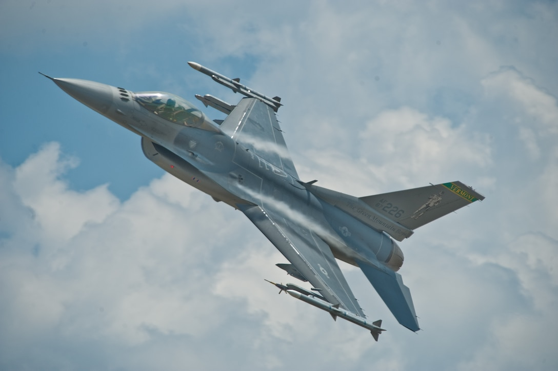 A 158th Fighter Wing F-16 soars into the blue during a two-week training the Vermont Air National Guard conducted in Alpena Mich. July 16, 2013. (U.S. Air National Guard photo by A1C Jon Alderman)