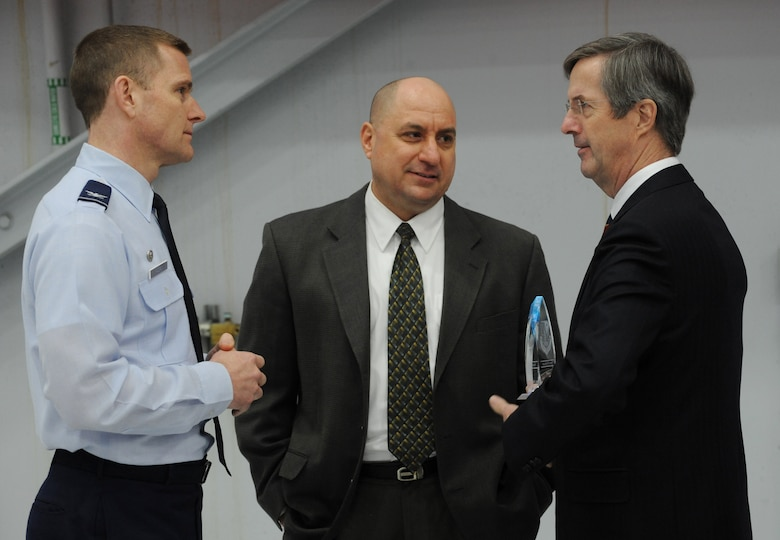 Oregon Air National Guard Col. Rick Wedan, 142nd Fighter Wing Commander (left), talks with Col. Mark Crosby (center), the Port of Portland's Chief of Public Safety and the Director of the State Partnership program, and Mr. Bill Wyatt (right), Executive Director for the Port of Portland after the ceremony to honor the Portland of Portland as the Oregon Air National Guard Employer of the Year award for 2013, held at the Portland Air National Guard Base, Ore., Feb. 20, 2014. (Air National Guard photo by Tech. Sgt. John Hughel, 142nd Fighter Wing Public Affairs/Released)