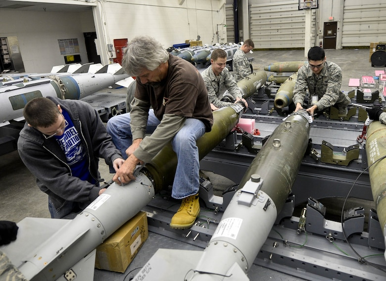 Members of the 28th Munitions Squadron assemble five GBU-31 Laser Joint Direct Attack Munitions during the Combat Hammer exercise at Ellsworth Air Force Base, S.D., Feb. 11, 2014. The squadron inspects and assembles more than 1,707 munitions annually, ensuring Ellsworth B-1 bomber aircrews have the payloads necessary to meet taskings anywhere on the globe. (U.S. Air Force photo by Senior Airman Zachary Hada/Released)