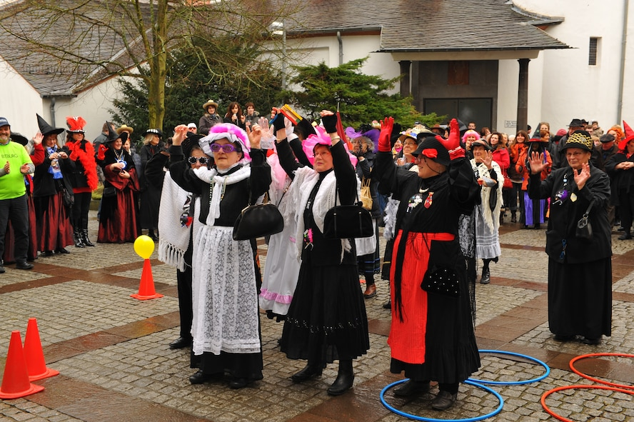 "Female citizens of Bitburg, Germany, participate in a Fashing event outside their city hall in Bitburg, Germany, Feb. 16, 2012. During the German holiday tradition, the Fashing ""fool ladies"" attempt to seize control of the city from the mayor.  (U.S. Air Force photo Airman 1st Class Dillon Davis / Released)"