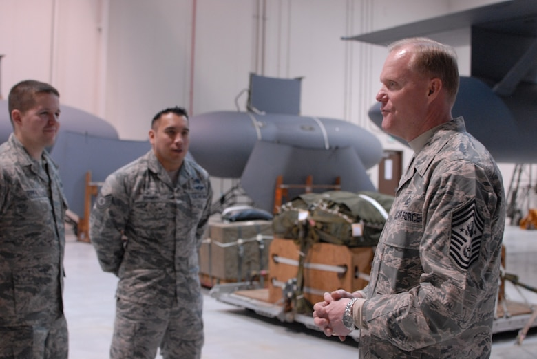 Chief Master Sgt. of the Air Force James A. Cody speaks with Airmen of the 193rd Special Operations Wing, Logistic Readiness Squadron Aerial Port. Chief Cody visited the 193rd Feb. 22-23 to get a firsthand look at the wing's Commando Solo mission and speak with Airmen about challenges they face. (U.S. Air National Guard photo/Senior Airman Claire Behney)