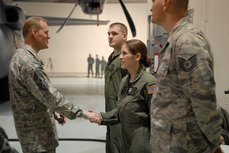 Chief Master Sgt. of the Air Force James A. Cody presents a coin to Tech. Sgt. Donielle Stewart, 193rd Special Operations Wing EC operator, for outstanding service. Chief Cody visited the 193rd Feb. 22-23 to get a firsthand look at the wing's Commando Solo mission and speak with Airmen about challenges they face. (U.S. Air National Guard photo/Senior Airman Claire Behney)