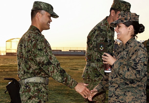U.S. Marine Cpl. Abigail V. Reynolds, right, an interpreter assigned to the 15th Marine Expeditionary Unit, greets a Japanese interpreter with the Japan Ground Self-Defense Force, at helocast training during Exercise Iron Fist 2014 aboard Naval Amphibious Base Coronado, Calif., Jan. 27, 2014. Reynolds is a landing support specialist with Combat Logistics Regiment 27, 2nd Marine Logistics Group, aboard Marine Corps Base Camp Lejeune, N.C. (U.S. Marine Corps photo by Cpl. Emmanuel Ramos/Released)