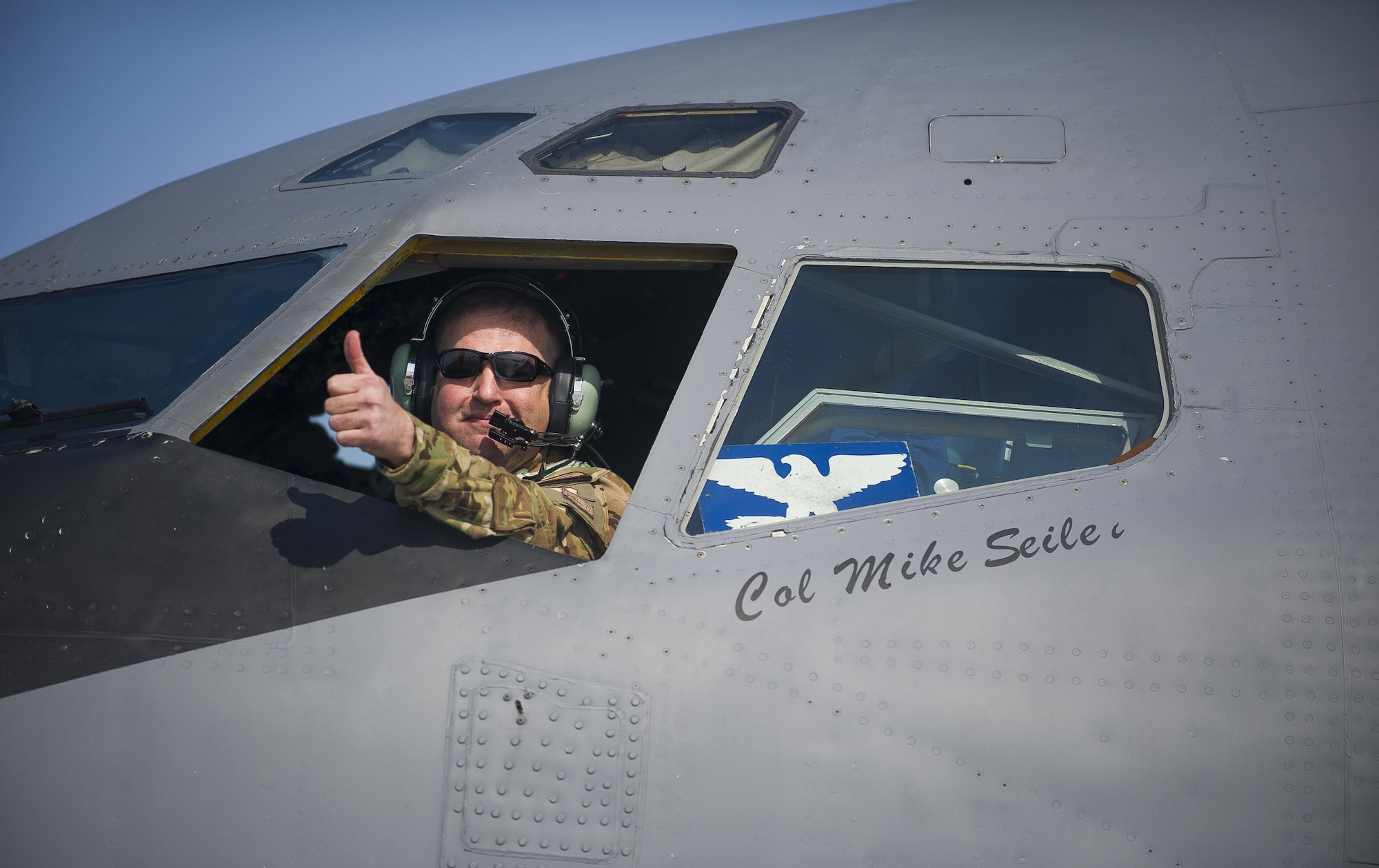 Col. Mike Seiler gives a thumbs up after completing the last refueling flight originating from Transit Center at Manas, Kyrgyzstan, Feb. 24, 2014. Seiler is the 376th Expeditionary Operations Group commander. (U.S. Air Force photo/Senior Airman George Goslin)