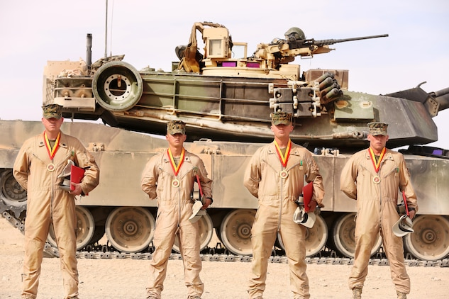 Staff Sgt. Kevin Cook, tank commander, Cpl. Matthew Gonzales, gunner, Lance Cpl. Jonathon Shaver, loader, and Lance Cpl. Trevor Lambert, driver, all with 1st Tanks came out ahead of the rest in the 11th Annual Tank Gunnery Competition, at Range 500, Feb. 20, 2014.