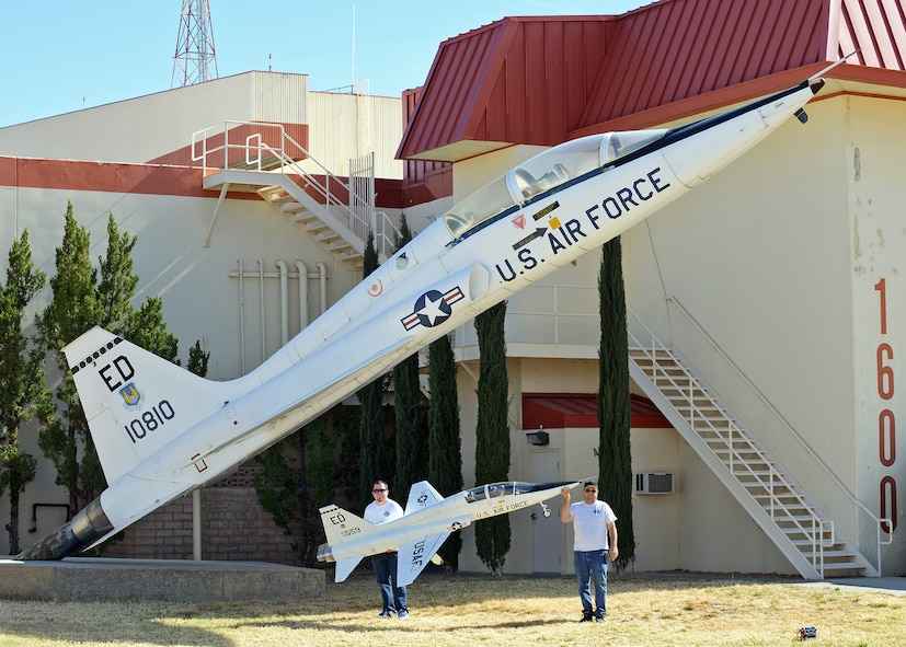 Rodger (right) and Brent Hecht pose with their 12-foot long T-38 Talon radio-controlled scale model next to a T-38A model in front of Building 1600 on Feb. 22, 2014 to show the scale comparison to the actual aircraft. The T-38A, tail number 10810, was placed in front of Building 1600 on October 1983. Rodger and Brent started flying R/C models with the Muroc Model Masters R/C Club nearly 20 years ago and decided to build their T-38 with an 82-inch wingspan. The fully-functional model weighs approximately 45 pounds, has two 5-inch electric ducted fans powered by brushless motors and the airframe is made of blue foam, carbon fiber, fiber glass, balsa wood and plywood. (U.S. Air Force photo by Jet Fabara)