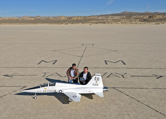 Rodger (left) and Brent Hecht pose with their 12-foot long T-38 Talon radio-controlled scale model on the Rosamond Dry Lakebed at the designated Muroc Model Masters flying field on Feb. 22, 2014. Rodger and Brent started flying R/C models with the Muroc Model Masters R/C Club nearly 20 years ago and decided to build their T-38 with an 82-inch wingspan. The fully-functional model weighs approximately 45 pounds, has two 5-inch electric ducted fans powered by brushless motors and the airframe is made of blue foam, carbon fiber, fiber glass, balsa wood and plywood. (U.S. Air Force photo by Jet Fabara)