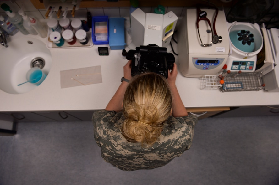 Jenna Giordano, a 52nd Medical Group veterinary technician from Milford, Del., performs lab work Nov. 14, 2013, at Spangdahlem Air Base, Germany. The clinic provides medical treatment to more than 20 animals a day. (U.S. Air Force photo by Senior Airman Rusty Frank/Released)